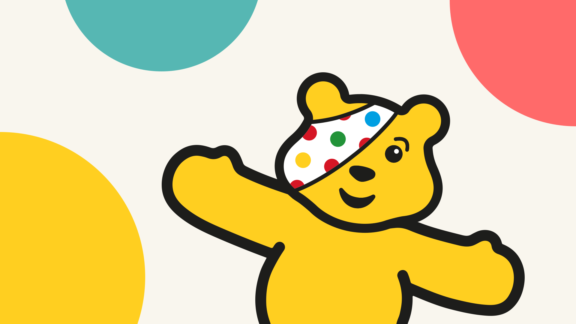 Pudsey against a spotty background.