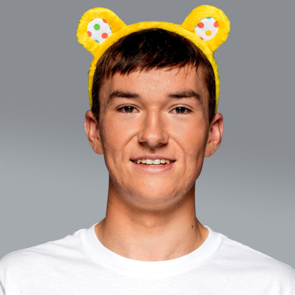 An image of Josh wearing Pudsey ears